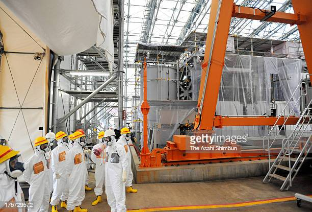 Members of Fukushima Prefecture panel inspects ALPS multiple nuclide removing system at the crippled Fukushima Daiichi Nuclear Power Plant on August...