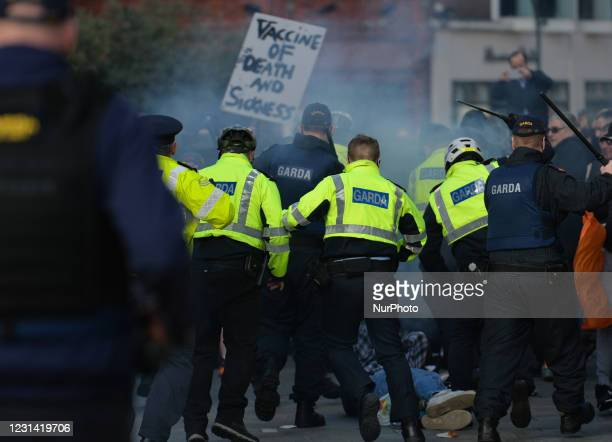 Members of Garda clash with protesters during Anti-Lockdown protest on Grafton Street in Dublin city center during Level 5 Covid-19 lockdown. On...