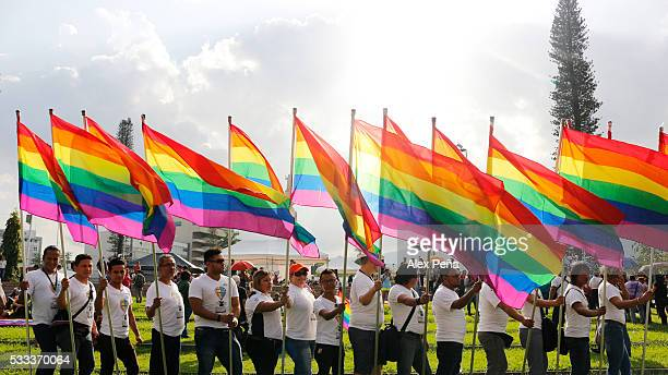 Members of gay and lesbian community protest against homophobia durng a parade on May 21 2016 in San Salvador El Salvador