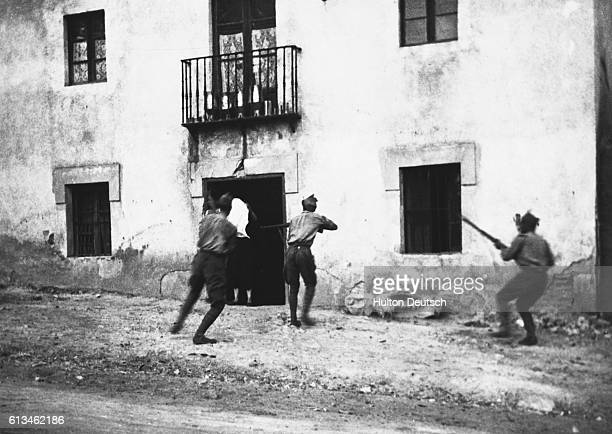 Members of General Franco's fascist troops searching a house at Burgos