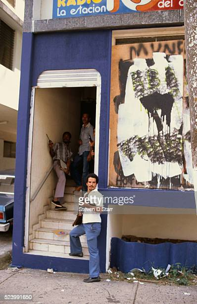 Members of General Manuel Noriega's paramilitary police force stand in a stairwell. Noriega rose to power in Panama during the 1980s and ruled until...