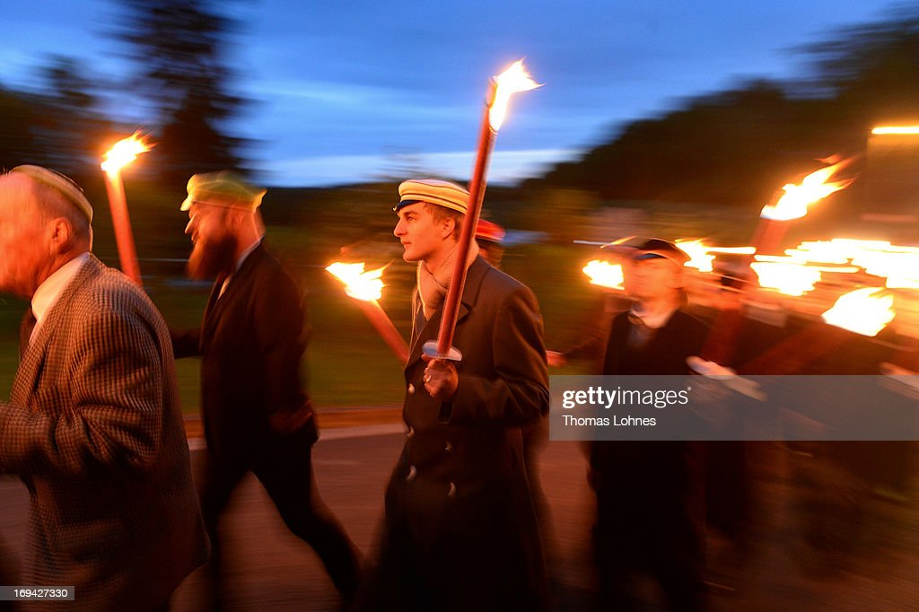 Members of German traditional university fraternities, in German called Burschenschaften, carry torches to the Burschenschaft Monument on May 24, 2013 in Eisenach, Germany. The Burschenschaftenm, who are holding their annual meeting in Eisenach, originated in 1815 among university students who volunteered to fight Napoleon.