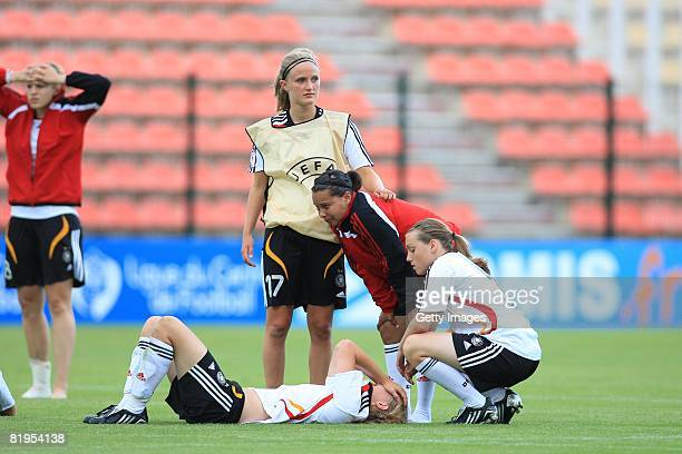 Members of Germany look dejected after the Women's U19 European Championship match between Germany and Norway at Valle du Cher stadium on July 16,...