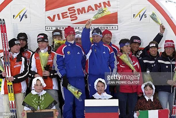 Members of Germany's 4x5 km women relay team, Manuela Henkel, Viola Bauer, Anke Reschwann Schulze, and Claudia Kuenzel) pose on the podium next to...
