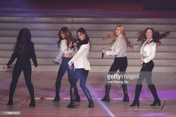 Members of girl group MoMoLand performs onstage during the PyeongChang 2018 Olympic and Paralympic Winter Games 1st Anniversary Festival In Gangneung...