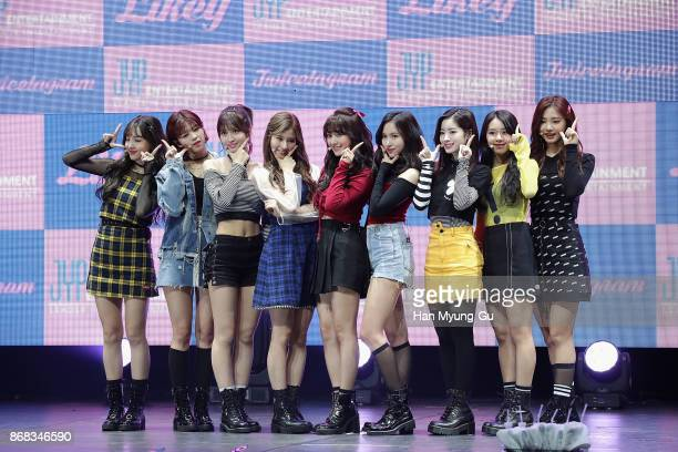 Members of girl group TWICE attend the press showcase for their 1st Album 'Twicetagram' on October 30 2017 in Seoul South Korea