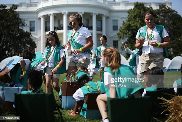 Members of Girl Scouts take their seats for a session with first lady Michelle Obama during the firstever White House Campout June 30 2015 at South...