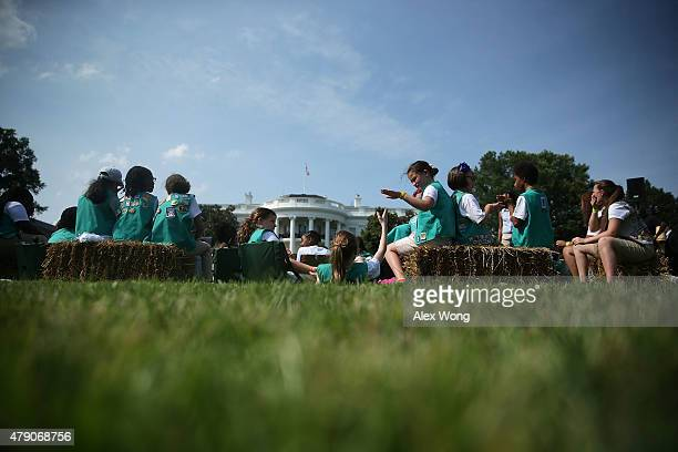 Members of Girl Scouts wait for first lady Michelle Obama during the firstever White House Campout June 30 2015 at South Lawn of the White House in...