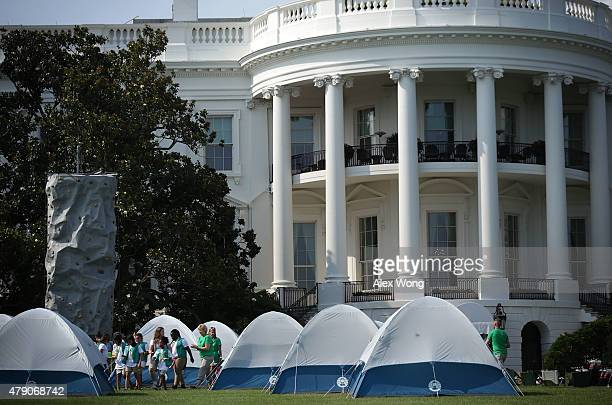 Members of Girl Scouts walk on the South Lawn during the firstever White House Campout June 30 2015 at the White House in Washington DC The first...