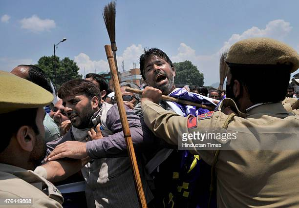 Members of Government Urban Local Bodies Employees United Forum shout slogans as police men trying to stop them during a protest march on June 9 2015...
