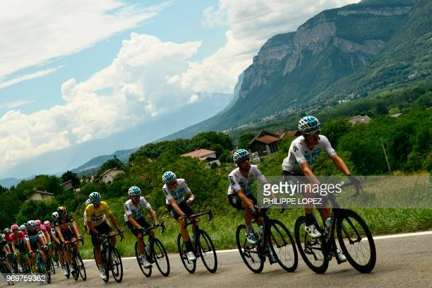 Members of Great Britain's Sky cycling team with Italy's Gianni Moscon wearing the overall leader's yellow jersey lead the pack chasing a breakaway...