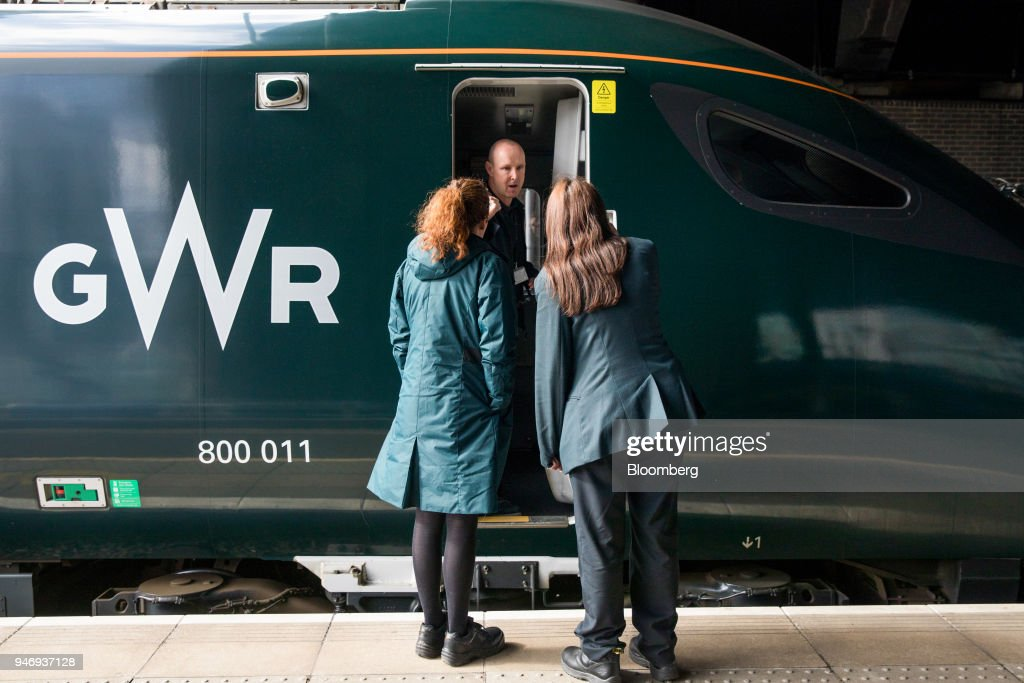 Members of Great Western Railway staff talk to a train driver at London Paddington railway station in London, U.K., on Monday, April 16, 2018. British train and bus operator FirstGroup Plc, which operates the Great Western Railway, said it rejected an 'opportunistic' takeover proposal that private-equity firm Apollo Management made as the company struggles with under-performing rail routes in the U.K. and competition from discount airlines in the U.S. Photographer: Jason Alden/Bloomberg via Getty Images