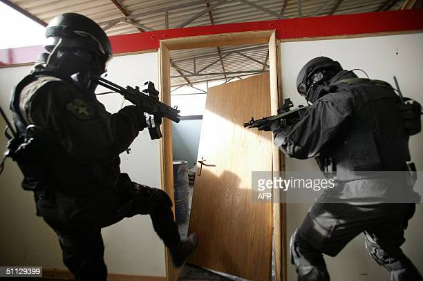 Members of Greek police special forces knock break down a door during an exercise in an unidentified location, in an undated photo released by the...