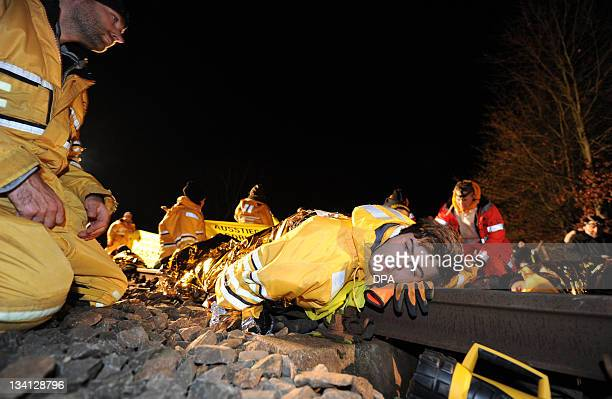 Members of Greenpeace have chained themselves to the train tracks near the northern German city of Lueneburg on November 26 2011 The train carrying...