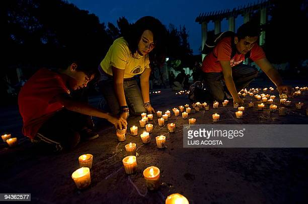 Members of Greenpeace ligth candles during a demonstration against Climate Chage in Mexico City on December 12 2009 In the framework of worldwide...
