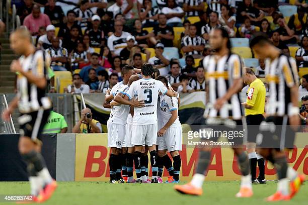 Members of Gremio celebrate a goal against Botafago during a match between Botafogo and Gremio as part of Brasileirao Series A 2014 at Maracana...