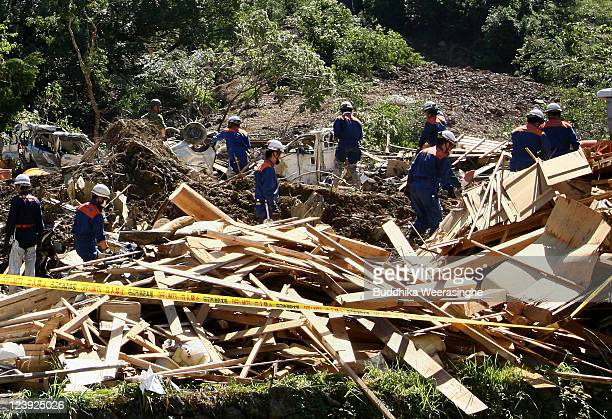 Members of Ground SelfDefense Force firefighters and police officers continue the search for missing people among the debris of houses destroyed by a...