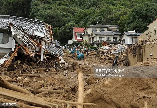 Members of Ground Self-Defense Force, firefighters and police officers continue the search for missing people among the debris of houses destroyed by...