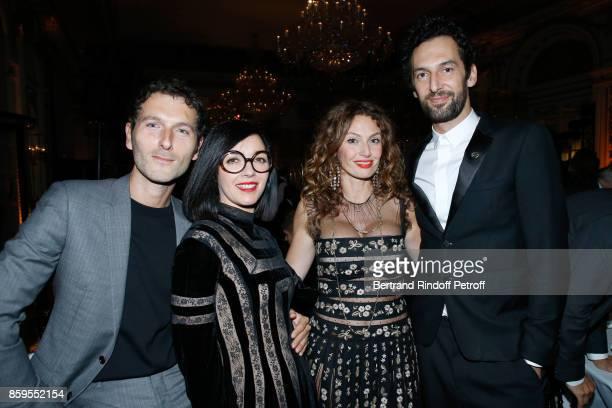 Members of Group AaRon Olivier Coursier and Simon Buret with Members of Musical Group 'Brigitte' Aurelie Saada and Sylvie Hoarau attend the 'Diner...