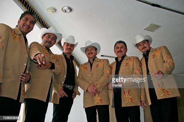 Members of group Los Invasores de Nuevo Leon pose for a photograph during a press conference to present their new album Dejate Llevar on August 26...