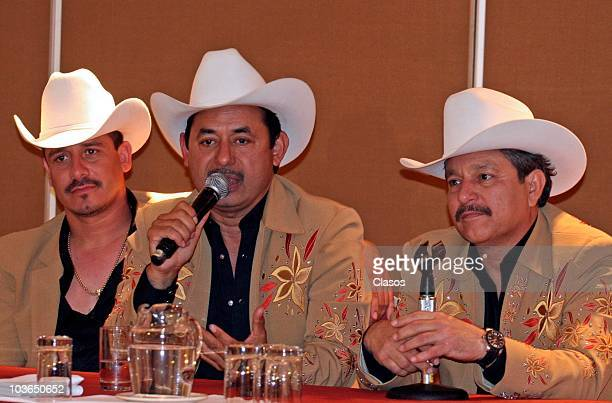 Members of group Los Invasores de Nuevo Leon speak during a press conference to present their new album Dejate Llevar on August 26 2010 in Mexico...