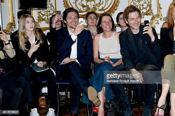 Members of group Something's Fishy Raphael Personnaz and Audrey Ismael Simon Buret attend the Alexis Mabille show as part of Paris Fashion Week Haute...