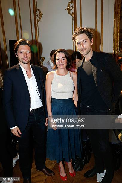 """Members of group """"Something's Fishy"""" Raphael Personnaz and Audrey Ismael, Simon Buret attend the Alexis Mabille show as part of Paris Fashion Week -..."""