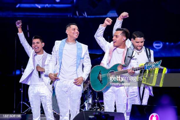 Members of Grupo Firme receive a declaration at Staples Center at Staples Center on July 30, 2021 in Los Angeles, California.