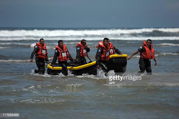 Members of Guatemalan elite commando Kaibiles come out of the sea during a competition in La Costa del Sol beach 61 km south from San Salvador El...