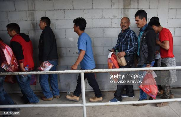 Members of Guatemalan immigrant families who tried to illegally cross to the United States arrive at the Air Force base in Guatemala City after being...