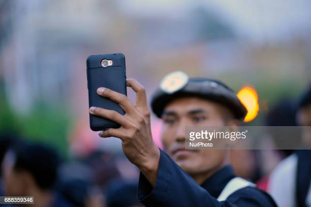 Members of Gurju Paltan Army personnel taking picture during celebration of Bhoto Jatra festival at Jawalakhel Patan Nepal on Thursday May 25 2017...