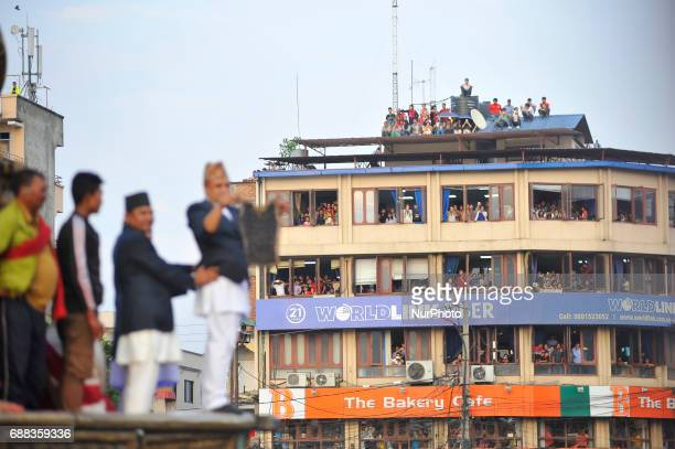 Members of Guthi Sansthan displaying the bejeweled vest known as Bhoto to the public from the chariot on celebration of Bhoto Jatra festival at...