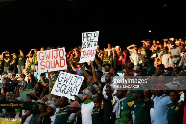 Members of Gwijo Squad, a sports fans movement, hold posters in support of the South African Rugby National Team during the 2019 Rugby Union World...