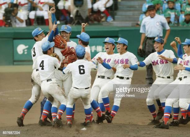 Members of Hanasaki Tokuharu celebrate after beating Koryo 144 in the final of the national high school baseball championship at Koshien Stadium in...