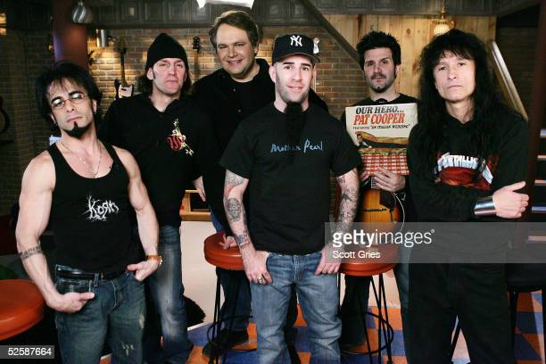 Members of heavy metal band Anthrax Danny Spitz, Frank Bello, host Eddie Trunk, Scott Ian, Charlie Benante, and Joey Belladonna pose for a photo...
