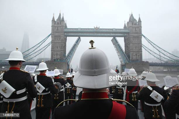 Members of Her Majesty's Royal Marine Band Plymouth play in the pouring rain during the Diamond Jubilee River Pageant on June 3 2012 in London...