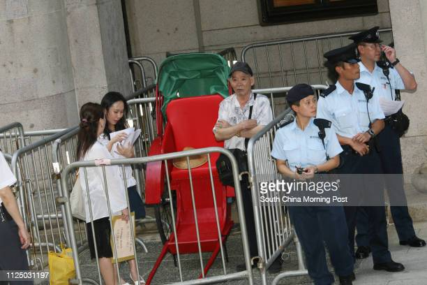 Members of Heritage Watch petition Secretary for Home Affairs Dr Patrick Ho Chiping with a rickshaw outside Legco to ask for the preservation of...