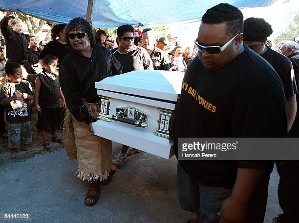 Members of his family carry the body of slain bystander Halatau Naitoko as he is returned to his family home on January 25 2009 in Auckland New...