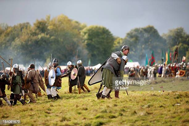 Members of historical reenactment groups assume the role of Saxon and Norman soldiers for the annual reenactment of the Battle of Hastings at Battle...