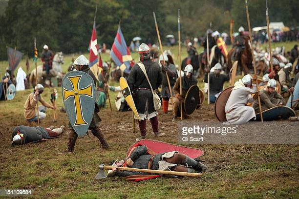 Members of historical reenactment groups assume the role of Saxon and Norman soldiers in the annual reenactment of the Battle of Hastings at Battle...