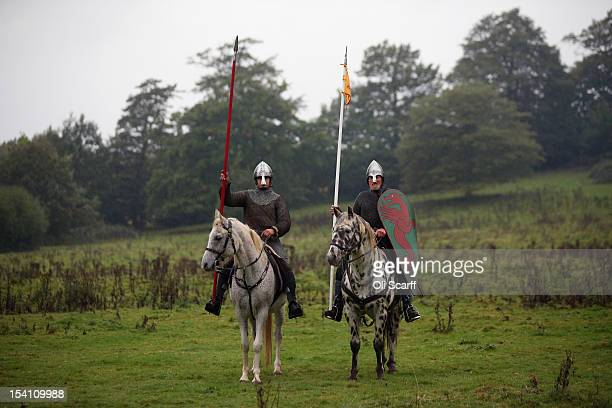 Members of historical reenactment groups assuming the role of Norman cavalry practice before the annual reenactment of the Battle of Hastings at...