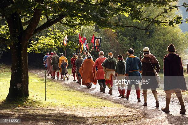 Members of historical reenactment groups assuming the role of Norman soldiers depart their encampment to perform the annual reenactment of the Battle...