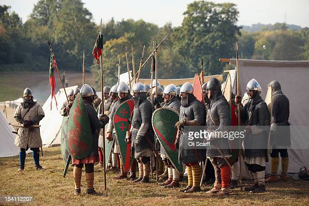 Members of historical reenactment groups assuming the role of Norman soldiers prepare to depart their encampment to perform the annual reenactment of...