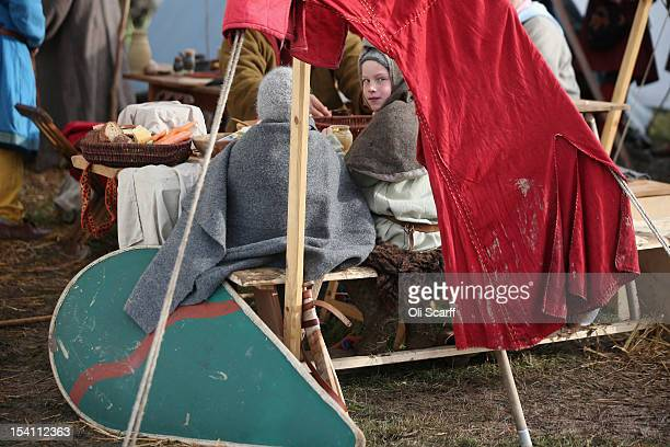Members of historical reenactment groups assuming the role of Norman soldiers eat before departing their encampment to perform the annual reenactment...
