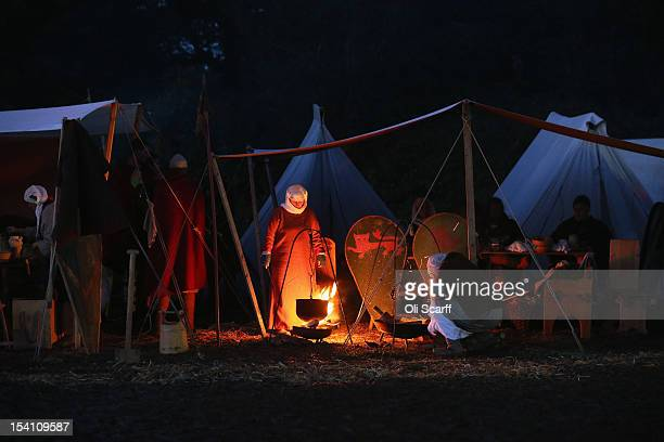 Members of historical reenactment groups cook a meal in their Norman encampment following the annual reenactment of the Battle of Hastings at Battle...