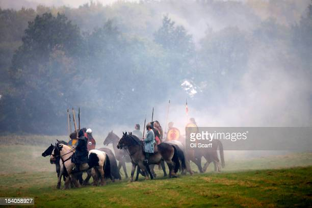 Members of historical reenactment groups prepare to assume the role of Norman soldiers for the annual reenactment of the Battle of Hastings at Battle...