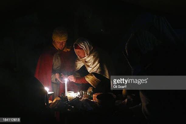 Members of historical reenactment groups relax in their Norman encampment following the annual reenactment of the Battle of Hastings at Battle Abbey...