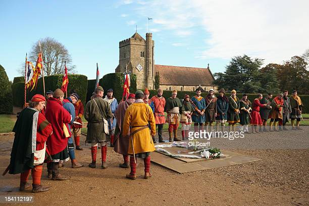 Members of historical reenactment groups say a prayer at Battle Abbey for the soldiers who died in the Battle of Hastings on the 946th anniversary of...