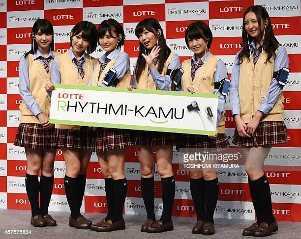 Members of HKT48 a girls pop group Natsumi Matsuoka Sakura Miyawaki Haruka Kodama Rino Sashihara Mio Tomonaga and Madoka Moriyasu pose in a photo...