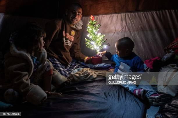 TOPSHOT Members of Honduran migrant family Aguilar Duarte who travelled with the Central American migrants caravan to the MexicoUS border pose for a...